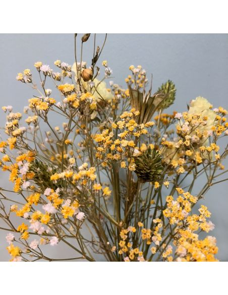 bouquet jaune dans sa mini dame jeanne verte